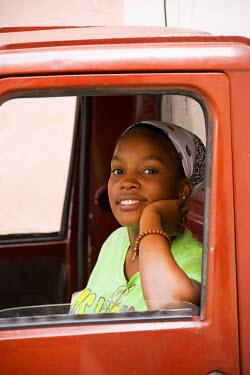 IBLTDR03809592 Woman looking out of a car window, Havana, Cuba