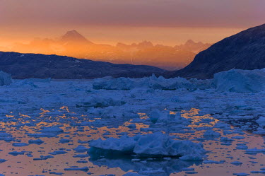 IBLOMK02052671 Midnight sun, ice and icebergs, Johan Petersen Fjord, East Greenland, Greenland