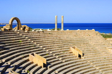 IBLGUF00234187 Curved rows of seats, theatre, Roman ruins, Leptis Magna, Libya, Africa