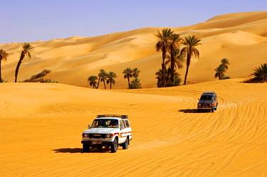 IBLGVA01414164 Toyota jeep on a desert road in the Mandara valley, Ubari Sand Sea, Sahara, Libya, Africa