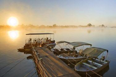 IBLHAN01089864 Wharf of the Mahangu Safari Lodge at dawn, Okavango, Namibia, Africa