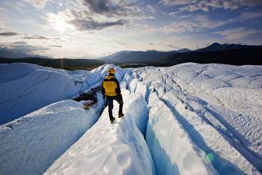 IBLVCH03721290 Mountaineer standing on Matanuska Glacier, Matanuska Glacier, Alaska, United States