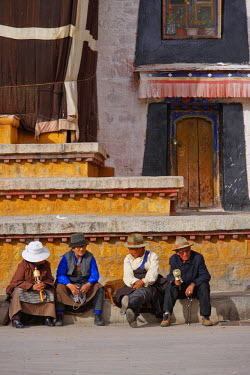 INT00926243 Tibet, Pilgrims sitting in front of the Jokhang temple, Lhassa,