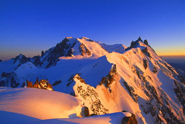 INT00927053 France, The aiguille du Midi (3842m) and Mont-Blanc (4810m) at sunrise, this summit is reatched by one of the highest cable car in Europe, Chamonix, Chamonix, France