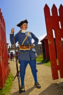 INT00958393 Canada, Nova Scotia, Soldier guarding the gate at the entrance to the Fortress of Louisbourg National Historic Site, Fleur de lis Trail,