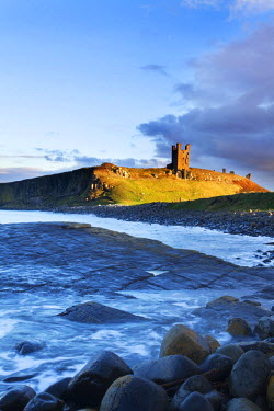 INT01050213 Great Britain, England, Embleton, Dunstanburgh Castle at Sunset Northumberland Coast
