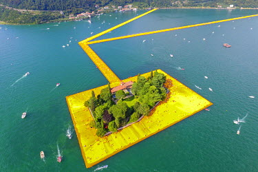 CLKAB46904 Aerial view of The Floating Piers in Iseo Lake, Brescia, Italy, Europe.
