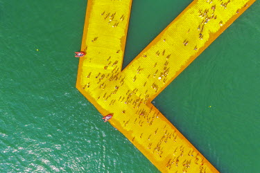 CLKAB46906 Aerial view of The Floating Piers in Iseo Lake, Brescia, Italy, Europe