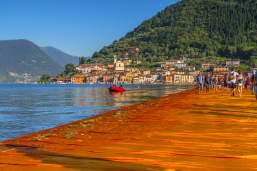 CLKAB47137 Walking on The Floating Piers in Iseo Lake, Brescia, Italy, Europe