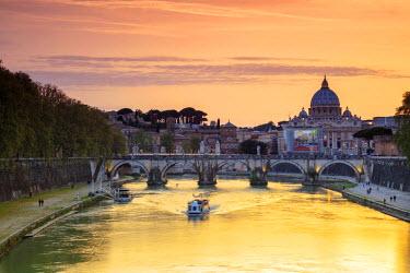 CLKRM48202 A romantic sunset on Tiber River with bridge Umberto I and Basilica di San Pietro in the background Rome Lazio Italy Europe