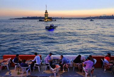 IBLMAN03093880 Evening mood, cafe on the Bosphorus, Maiden's Tower or Leander's Tower, Kiz Kulesi, Bosporus, Uskudar, Istanbuln and european side, Istanbul Province, Turkey