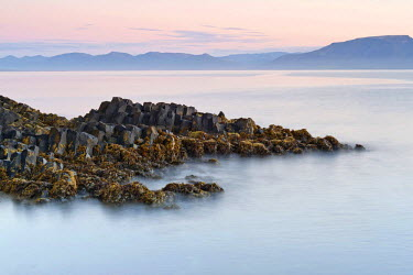 IBLOMK02110215 Basalt rock formations on the coast near Hofsos, Skagafjoerdur bay, northern Iceland, Iceland