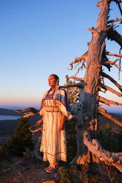 USA11370AW Native woman, Acosia M. Red Elk, in historic buckskin dress on top of Paulina Peak, Central Oregon, USA. (MR)