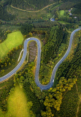 IBXBLO03985074 Aerial view, hairpin curves, winding road in the Sauerland forests, between Herscheid and Halver, North Rhine-Westphalia, Germany