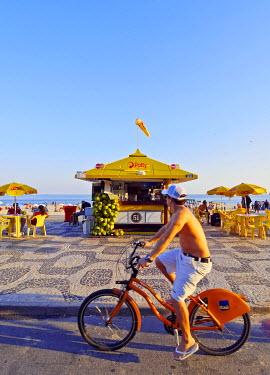 BRA3140AW Brazil, City of Rio de Janeiro, Biking at Ipanema Beach.