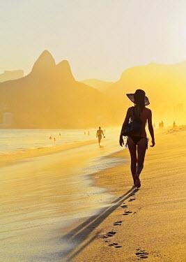 BRA3143AW Brazil, City of Rio de Janeiro, Ipanema Beach and Morro Dois Irmaos at sunset.