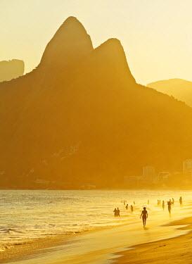 BRA3145AW Brazil, City of Rio de Janeiro, Ipanema Beach and Morro Dois Irmaos during sunset.