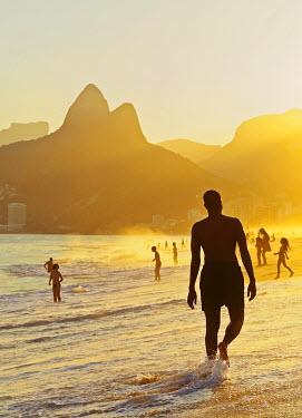 BRA3147AW Brazil, City of Rio de Janeiro, Ipanema Beach and Morro Dois Irmaos during sunset.