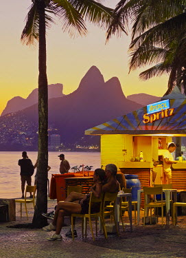 BRA3148AW Brazil, City of Rio de Janeiro, Beach Bar at the Ipanema Beach with a view of the Morro Dois Irmaos.