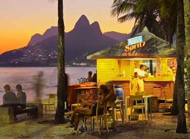 BRA3149AW Brazil, City of Rio de Janeiro, Beach Bar at the Ipanema Beach with a view of the Morro Dois Irmaos.