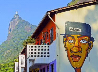 BRA3181AW Brazil, City of Rio de Janeiro, View of the Favela Santa Marta  with Corcovado and the Christ Statue behind.