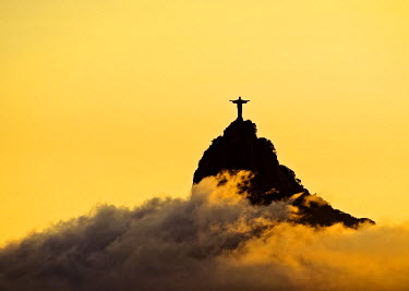 BRA3186AW Brazil, City of Rio de Janeiro, Sunset view of the Christ the Redeemer and Corcovado Mountain.