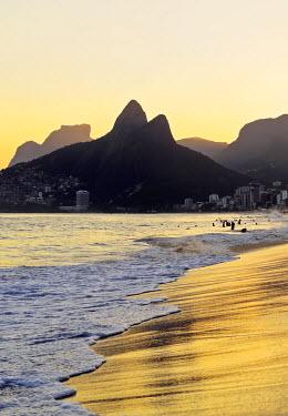 BRA3290AWRF Brazil, City of Rio de Janeiro, Ipanema Beach and Morro Dois Irmaos during sunset.