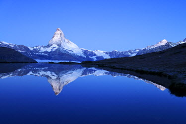 IBXSHU03738034 Mt Matterhorn reflected in Stellisee Lake at dusk, Zermatt, Canton of Valais, Switzerland