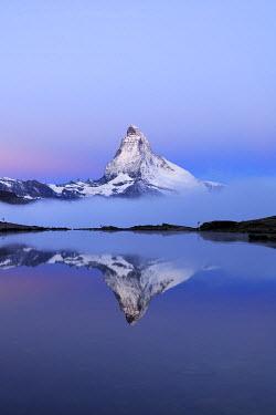 IBXSHU03738820 Matterhorn reflected in Lake Stellisee at dusk, Valais Alps, Canton of Valais, Switzerland