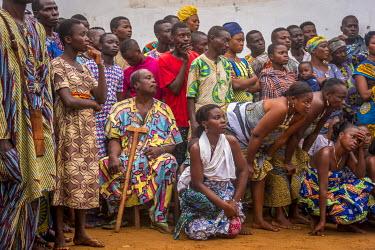 BNN0073AW Africa, Benin, Ouidah. Spectators of a voodoo ceremony.