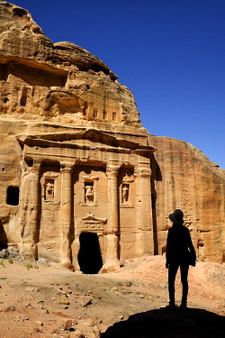 HMS2103055 Jordan, Nabataean archeological site of Petra, listed as World Heritage by UNESCO, silhouette of a woman watching the fa�ade of the Roman Soldier's Tomb, carved out of a sandstone rock face