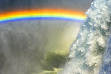 ZAM7939AW Africa, Zambia. The Victoria Falls with the rainbow.