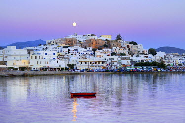 IBXGZS00898007 Red wooden boat in the sea in front of white houses, full moon in the pink evening sky over Naxos City with Castro, Venetian fortress, Cyclades, Greece