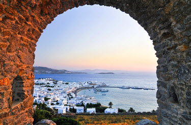 IBXGZS00898748 View through an old stone archway towards the old port of Mykonos, Cyclades, Greece