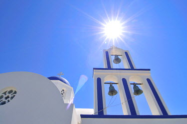 IBXGZS00903391 Church and bell tower against the sun in front of a blue sky, Mykonos, Cyclades, Greece