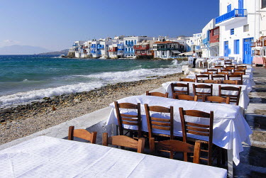 IBXGZS00905881 Tables at a restaurant on the waterfront located in front of Little Venice District in Mykonos, Cyclades, Greece
