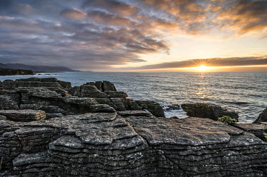 IBXGZS02301825 Sunset at Pancake Rocks, Paparoa National Park, Punakaiki, South Island, New Zealand, Oceania