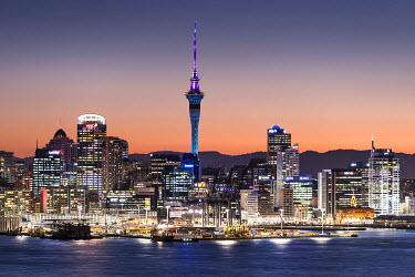 IBXGZS03867165 Skyline of Auckland with the Sky Tower at dusk, Auckland, North Island, New Zealand, Oceania