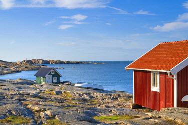 IBXDJS01093470 Green and red wooden houses on the sea, Smoegen, Bohuslaaen, Sweden