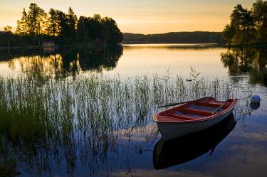 IBXDJS01642481 Sunset on a lake near Bengtsfors, Sweden