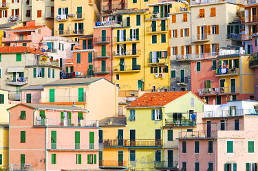 IBXGZS00852819 Facades of houses nestled together in Manarola, Liguria, Cinque Terre, Italy