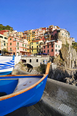 IBXGZS00852825 Village of Manarola with a fishing boat in the foreground, Liguria, Cinque Terre, Italy