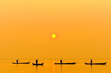 IBXOMK02373852 Fishermen fishing on Lake Vembanad at sunrise, Kerala, southern India, India