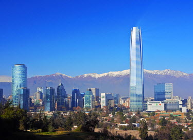 CHI10462AW Chile, Santiago, View from the Parque Metropolitano towards the high raised buildings with Costanera Center Tower, the tallest building in South America. Snow covered Andes in the background.