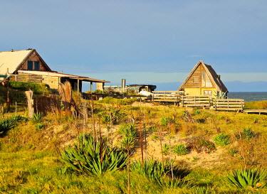 URU0317AWRF Uruguay, Rocha Department, Punta del Diablo, Houses near la Viuda Beach.