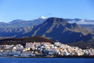 IBXMAN01791246 View on Los Cristianos and the snow-capped Mount Teide, Tenerife, Canary Islands, Spain