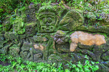 IBXGAB04041921 Moss-covered sculpture in the forest, Goa Gajah Elephant Cave complex, Bali, Indonesia