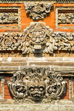 IBXGAB04041965 Pura Taman Ayun Temple, sculptures of the Bale basement, wood pavilion, Mengwi, Bali, Indonesia