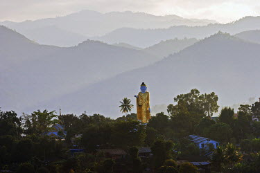 IBXHAL04194646 Big Buddha statue against the mountains in the Golden Triangle, Kyaing Tong, Shan State, Myanmar