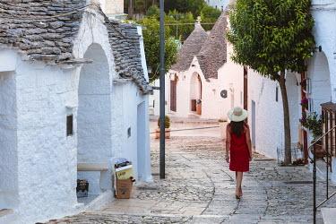 ITA9291AW Woman visiting the Trulli area, Alberobello, Itria valley, Apulia, Italy  (MR)